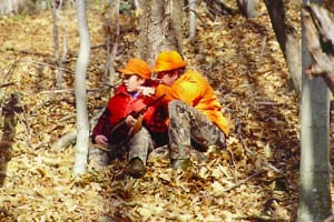 Hunter with Youth Boy - Orange Coat - Safety Fist