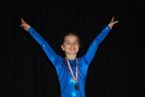 Chloe Reynolds, of Sunrise Gymnastics, won three Vermont championships in the vault, beam, and floor exercise at the Vermont USA Gymnastics Championships.