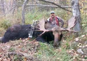 Kevin Rice of South Pomfret, VT with the archery record 919 lb. bull moose he took last year during Vermont's archery moose hunt.  Winners of moose permits for this year are on Vermont Fish &Wildlife's website. VTF&W photo by Steve Schaefer