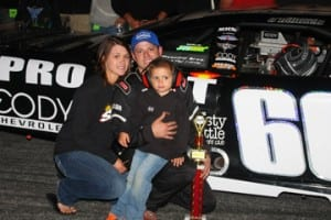 N. Haverhill, NH's Derrick O'Donnell celebrates his fourth Thunder Road Late Model win of the season with wife Abby and son Landyn. Alan Ward/Big Al's Photos photo