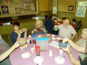 Last year's Souper Supper guests enjoy soup in their Third Branch Pottery bowls.