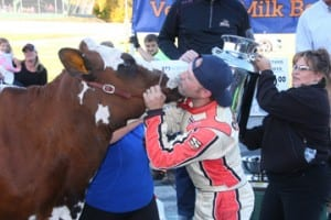 "Barre, VT's Nick Sweet plants a kiss on ""Miss Milk Bowl 2015"" after winning the 53rd Northfield Savings Bank Milk Bowl on Sunday, October 11. Photo by Alan Ward/Big Al's Photos photo"