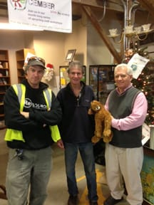 Jim Miller (center) thanks ReSOURCE Assistant Store Manager Terence Wendelken and Bob Kershaw, new manager of the Barre ReSOURCE store, for all the prizes and decorations for Saturday's event.
