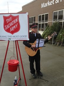 "Lt. Chris Street of the Barre Salvation Army plays his guitar and sings Christmas carols while raising money during the ""Kettle Drive""."