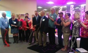 Autism Puzzle Foundation co-founder Randy Lamberti and Lt. Governor Phil Scott cut the ribbon at the unveiling of the Imagination Station in Washington County Mental Health Services' WellSpace building last Wednesday.