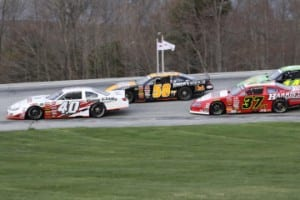 Barre's Nick Sweet (40VT) duels with Jimmy Hebert (58VT) and Scott Payea (37VT) on his way to victory in the Merchants Bank 150. Photo by Alan Ward