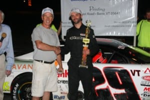 Jason Allen of Barre shows off his trophy in Victory Lane after claiming victory in the Late Model feature on Jet Service Envelope/Accura Printing Night at Thunder Road. Alan Ward photo