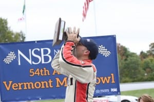 Nick Sweet of Barre drinks from the Milk Bowl after winning the 54th edition of the race for the second straight year, and the third time overall, at Thunder Road. Photo by Alan Ward
